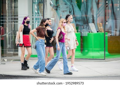Beverly Hills, CA: April 7, 2021:  Shoppers wearing masks in the downtown district of Beverly Hills. Beverly Hills is an upscale city in Los Angeles County.