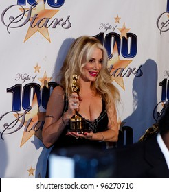 BEVERLY HILLS, CA - FEB. 26: Jennifer Young shows off father Gig Young's Oscar trophy at the 22nd Annual Night Of 100 Stars event held at The Beverly Hills Hotel on Feb. 26, 2012 in Beverly Hills, CA.