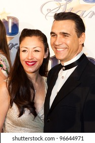 BEVERLY HILLS, CA - FEB. 26: Designer Alexandra Tonelli & actor Adrian Paul arrive for the 22nd Annual Night Of 100 Stars event held at The Beverly Hills Hotel on Feb. 26, 2012 in Beverly Hills, CA.