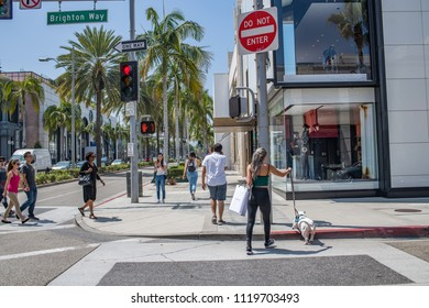 Beverly Hills, CA: June 21, 2018:  Tourists walking in the Rodeo Drive district of Beverly Hills. Rodeo Drive is an upscale shopping district in Beverly Hills.