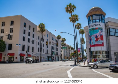 Beverly Hills, CA: June 26, 2018: Wilshire  Boulevard and Rodeo Drive, with traffic and buildings, in Beverly Hills.  Beverly Hills is an upscale city.