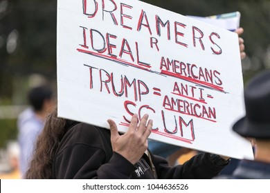 "BEVERLY HILLS, CALIFORNIA - MARCH 12, 2018: Sign that reads, ""Dreamers R Ideal Americans. Trump equals Anti-American Scum"" at the Defend Dreamers Rally hosted by Coalition for Humane Immigrant Rights."
