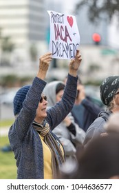 """BEVERLY HILLS, CALIFORNIA - MARCH 12, 2018: A protester holds a sign that reads, """"Protect DACA and Dreamers"""" at the Defend Dreamers Rally hosted by Coalition for Humane Immigrant Rights (CHIRLA)."""
