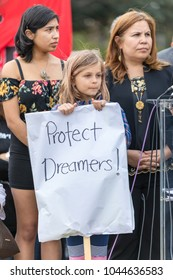 """BEVERLY HILLS, CALIFORNIA - MARCH 12, 2018: A young child holds a sign that reads, """"Protect Dreamers"""" at the Defend Dreamers Rally hosted by Coalition for Humane Immigrant Rights (CHIRLA)."""