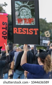 """BEVERLY HILLS, CALIFORNIA - MARCH 12, 2018: A protester holds a sign that reads, """"Why Trump? RESIST"""" at the Defend Dreamers Rally hosted by Coalition for Humane Immigrant Rights (CHIRLA)."""
