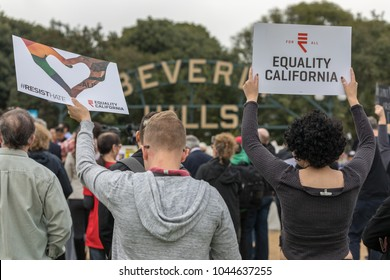 BEVERLY HILLS, CALIFORNIA - MARCH 12, 2018: Equality California signs from protesters at the Defend Dreamers Rally hosted by Coalition for Humane Immigrant Rights (CHIRLA).