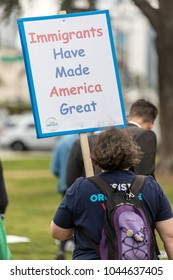 """BEVERLY HILLS, CALIFORNIA - MARCH 12, 2018: A protester holds a sign that reads, """"Immigrants Have Made America Great"""" at the Defend Dreamers Rally hosted by Coalition for Humane Immigrant Rights."""