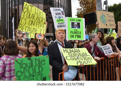 BEVERLY HILLS, CA/USA - SEPTEMBER 26, 2019: An activist at the climate strike dressed as President Donald Trump