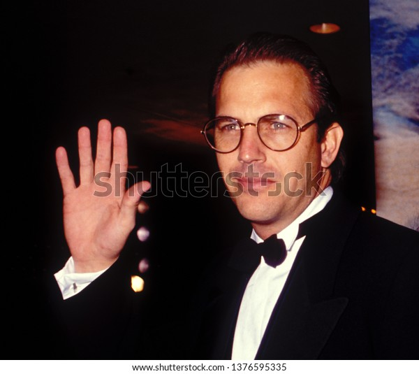 BEVERLY HILLS - circa 1991: Keven Costner waves as he leaves The Beverly Hilton Hotel.
