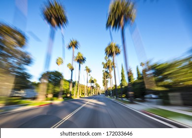 Beverly HIlls drive through with motion blur.