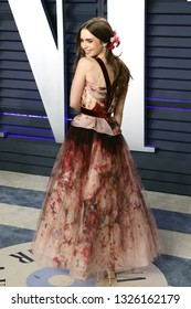 BEVERLY HILLS - FEB 24: Lily Collins at the 2019 Vanity Fair Oscar Party at The Wallis Annenberg Center for the Performing Arts on February 24, 2019 in Beverly Hills, CA