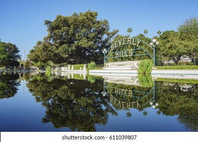 Beverly Hills, MAR 24: Beverly Hills Sign with reflection on MAR 24, 2017 at Beverly Gardens Park, Los Angeles, California