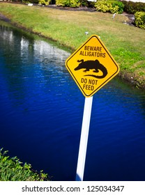 Beware Alligators warning sign by a creek on Sanibel Island, Florida