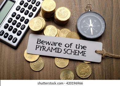 Beware of the pyramid scheme, financial concept