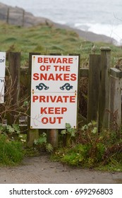 Beware of the snakes sign and Private Keep Out