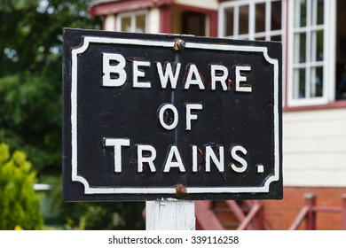 "Beware of Trains.  A ""Beware of Trains"" sign on the South Tynedale railway in Northern England."