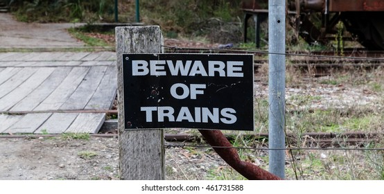 A beware of trains signs attached to a fence post, Zig Zag Railway, New South Wales, Australia.