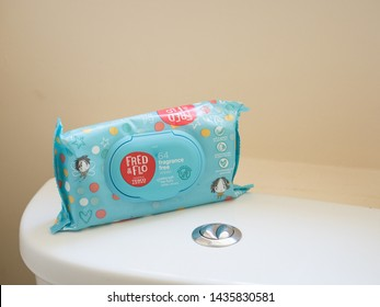 Bexhill on Sea,East Sussex / United Kingdom - June 27,2019: A packet of Fred and Flo wipes sit on top of a toilet - Image