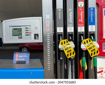 Bexhill-Sussex-UK-September 25,2021:Petrol pumps with sign saying 'sorry out of use' due to fuel delivery issues in Uk .Diesel, unleaded and supreme .Price digital display shows zero pence.