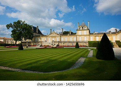 Beychevelle, France-08 23 2013:Facade building and formal garden of the Château Beychevelle, which is a winery in the Saint-Julien appellation of the Bordeaux region of France.