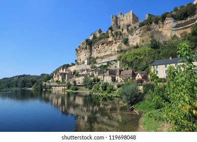 Beynac-et-Cazenac - beautiful village under the spectacular sandstone cliff on the river Dordogne, France