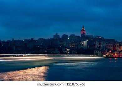 Beyoglu district historic architecture and Galata tower medieval landmark in Istanbul at night, Turkey