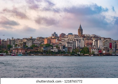 Beyoglu district historic architecture and Galata tower medieval landmark in Istanbul at sunset, Turkey