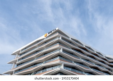 Beyoglu, Istanbul, Turkey - 03.12.2021: low angle view of building of Esta Residence under the Benasta Beyoglu project consisting of 245 flats in a 12-story single block under blue sky