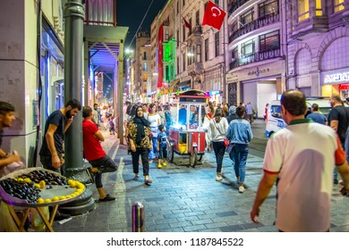 Beyoglu, Istanbul, Turkey - AGUST 20, 2018 Street vendor roasting and selling chestnuts from a mobile stall. Captured in nighttime.