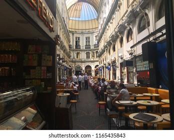 Beyoglu, Istanbul, Turkey - August 23, 2018: Interior details, restaurants, tables and people inside Cicek Pasaji.