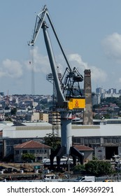 Beyoglu, Istanbul / Turkey - June 27th, 2019 : The tall crane of the Historical Golden Horn Shipyard stands mighty under the summer sun.