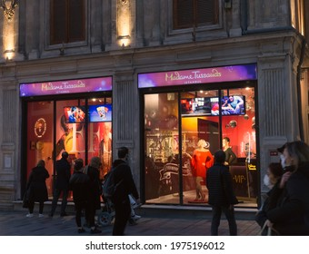 Beyoglu, Istanbul, Turkey - March 5th, 2021: Madame Tussauds screen and interested tourists at dusk during the COVID 19 Pandemic