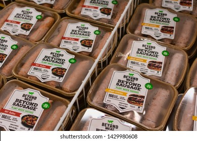 Beyond Meat brand plant-based Beyond Sausage packages looks, sizzles, and satisfies like traditional pork sausage in the meat section of Safeway grocery store - Cupertino, California, USA - June, 2019