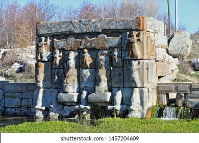 Beysehir, Konya / Turkey - March 24, 2019: The Hittite spring sanctuary of Eflatun Pinar lies about 100 kilometres west of Konya close to the lake of Beysehir in a hilly, quite arid landscape.