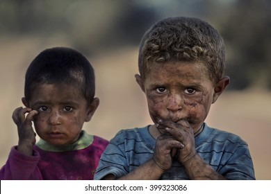Beysehir, Turkey - August 31, 2013 : Children of seasonal charcoal workers.These families migrate from Diyarbakir to the Central Anatolia and works in charcoal industry.Conditions are very difficult.