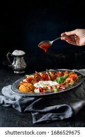 beyti turkish kebab, buttermilk and  sauce on the dark back ground