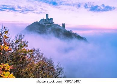 Bezdez castle over clouds in autumn, Czech republic