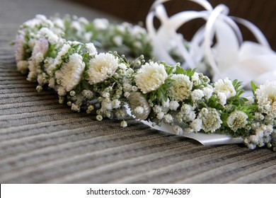 Bezel of white flowers. Beautiful wreath with white flowers, white and green field flowers with mixed foliage. White Flower Crown for bride.