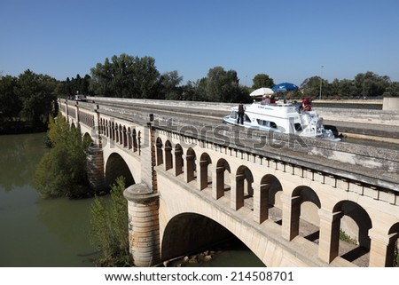 BEZIERS, FRANCE - OCT 2: Boat passing Orb Aqueduct of Canal du Midi in Beziers. October 2, 2011 in Beziers, Herault department, Languedoc-Roussillon, France