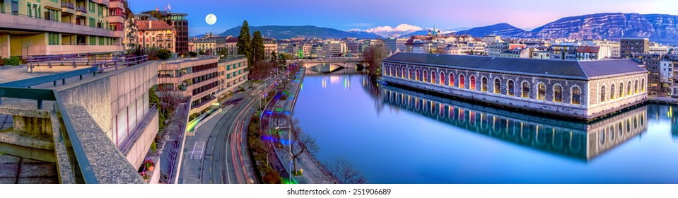 BFM, building and Rhone river by night with full moon, Geneva, Switzerland