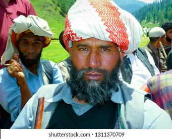BHADERWAH, JAMMU AND KASHMIR / INDIA - MAY 28, 2011: A middle-aged Kashmiri man from the remote Jai Valley looks into the camera, on May 28, 2011.