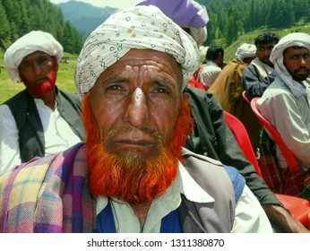 BHADERWAH, JAMMU AND KASHMIR / INDIA - MAY 28, 2011: A Kashmiri man with henna-dyed red beard looks at the camera at remote Jai Valley, on May 28, 2011.