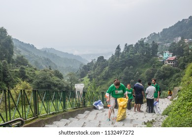 Bhagsu, Himachal Pradesh / India - July 12 2018 : The NGO Waste Warriors is busy cleaning up trash around the path to Bhagsu waterfall on a cool summer day in the Himalayas.