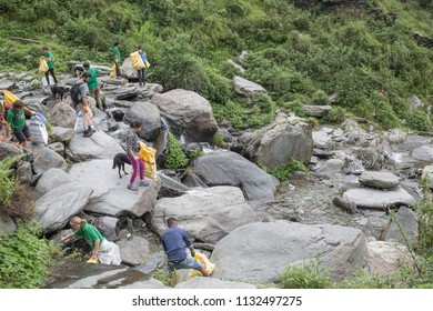 Bhagsu, Himachal Pradesh / India - July 12 2018 : The NGO Waste Warriors is busy cleaning up trash around Bhagsu waterfall on a cool summer day in the Himalayas.