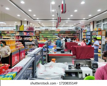 Bhairahawa, Nepal - April 23 2020: Unidentified People wearing face masks and purchasing goods while maintaining social distance at a grocery store at supermarket