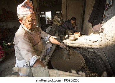 BHAKTAOUR, NEPAL - DEC 7, 2013 : Unidentified Nepalese man working in the his pottery workshop. More 100 cultural groups have created an image Bhaktapur as Capital of Nepal Arts.
