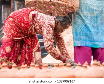 Bhaktapur - Nepal, 17 December 2018: Unidentified woman making a potter in Bhaktapur Durbar square, Nepal.