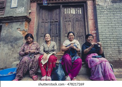 BHAKTAPUR, NEPAL, APRIL 25: Group of women in Bhaktapur smiling and working in the street. Nepal 2013.