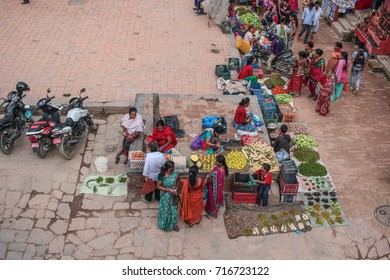 Bhaktapur, Nepal - August, 2017: Vegetable sellers in Taumadi Square in the ancient city of Bhaktapur, Nepal