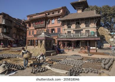 BHAKTAPUR, NEPAL - DEC 2, 2013: unidentified people work handcrafted Pottery on December 2, 2013 in Bhaktapur, Kathmandu Valley, Nepal
